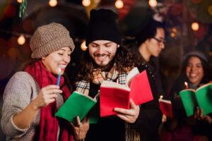 a man and a woman singing Mexican Christmas carols